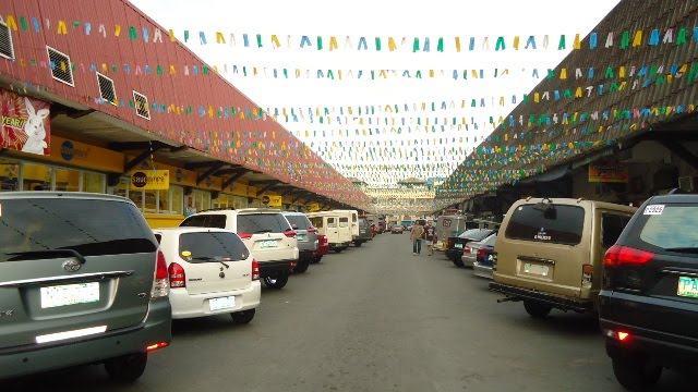 Cartimar Market is located in an older Manila strip mall and is always bustling with people, and animals of every shape and size.