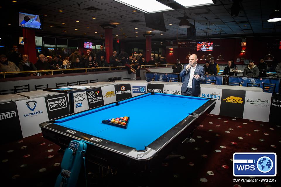 Appleton speaking the crowd at Steinway Billiards in New York City.