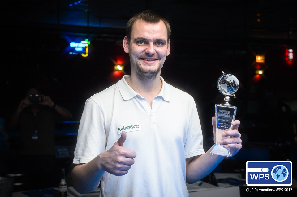 Russia's Ruslan Chinakov is all smiles after capturing the Molinari Players Championship at Steinway Billiards in New York City